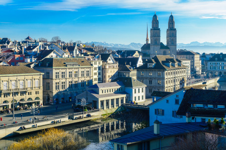 altstadt: ZURICH, SWITZERLAND - DECEMBER 27, 2015: View of the Old Town Altstadt, with the Grossmunster great minster Church, locals and visitors. In Zurich, Switzerland Editorial