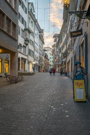 altstadt: ZURICH, SWITZERLAND - DECEMBER 24, 2015: Street scene in the Old Town Altstadt, with Christmas decorations, local businesses, locals and visitors. In Zurich, Switzerland
