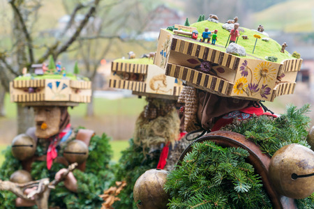 tradition: New Year Mummers near a farmhouse in Urnasch, Appenzell, Switzerland. Its part of the Silvesterchlausen tradition of greeting for the New Year