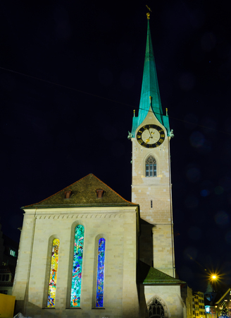 chagall: The exterior of the Fraumunster Women Minster Church at night, with its stained glass windows by Marc Chagall, in Zurich, Switzerland