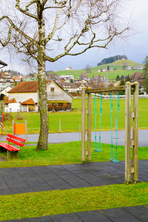appenzeller: Typical houses, a playground and countryside, in Appenzell, Switzerland