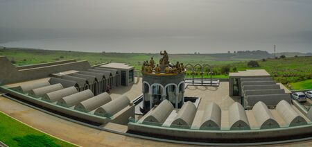 beatitude: KORAZIM, ISR - JAN 22, 2016: Panoramic view of the Sea of Galilee, with dormitories, Jesus and the 12 apostles and visitors, in the Domus Galilaeae Monastery, on the Mount of Beatitudes, Israel Editorial