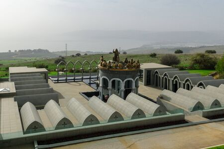 dormitories: View of the Sea of Galilee, with dormitories, Jesus and the 12 apostles, in the Domus Galilaeae House of Galilee Monastery, on the peak of Mount of Beatitudes, Israel Stock Photo