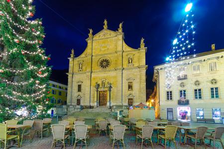 christmas church: Night view of Collegiata square, with Christmas decorations, and the Collegiata dei SS Pietro e Stefano church, in Bellinzona, Ticino, Switzerland