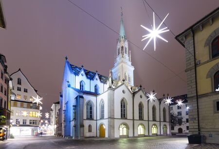 st gallen: Night view of the St. Laurenzen Kirche St. Lawrence Church, with Christmas decoration, in St. Gallen, Switzerland Stock Photo