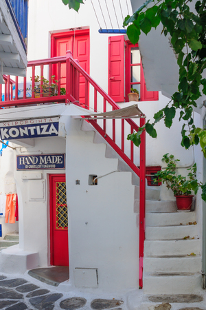 mykonos: MYKONOS, GREECE - OCTOBER 02, 2011: A street with typical Greek houses and local businesses, in Mykonos, Mykonos Island, Greece Editorial