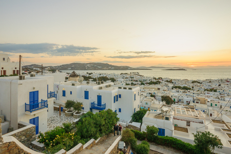 mykonos: MYKONOS, GREECE - OCTOBER 02, 2011: Sunset scene of the Village, with local businesses, windmills, locals and visitors, in Mykonos, Mykonos Island, Greece