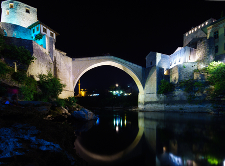 restored: The old city and the restored Old Bridge (Stari Most) at night, in Mostar, Bosnia and Herzegovina