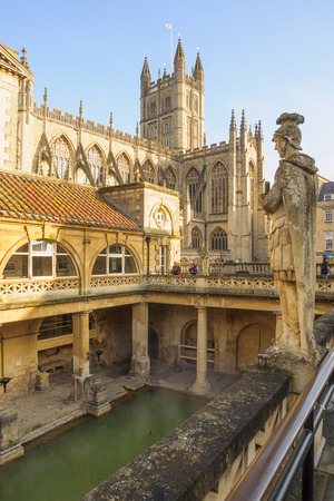 somerset: BATH, ENGLAND - FEB 18, 2013: The Ancient Roman Baths, with visitors, in Bath, Somerset, England