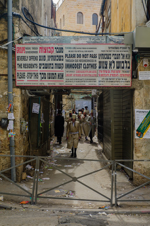 hasidic: JERUSALEM, ISRAEL - FEBRUARY 25, 2016: Street scene, with local orthodox Jews, in the ultra-orthodox neighborhood Mea Shearim, Jerusalem, Israel