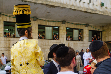 hasidim: JERUSALEM, ISRAEL - FEBRUARY 25, 2016: A crowd of ultra-orthodox Jews protest against the police, in the neighborhood of Mea Shearim, Jerusalem, Israel
