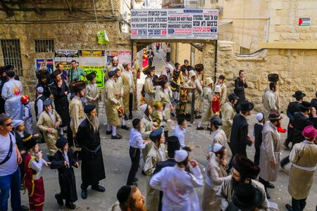hasidic: JERUSALEM, ISRAEL - FEBRUARY 25, 2016: A crowd of ultra-orthodox Jews protest against the police, in the neighborhood of Mea Shearim, Jerusalem, Israel