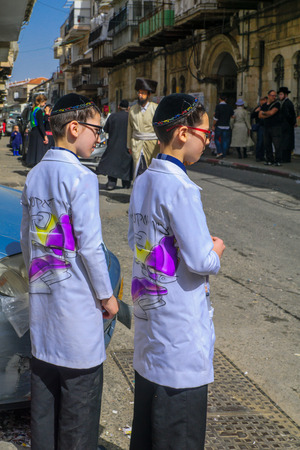 hasidic: JERUSALEM, ISRAEL - FEBRUARY 25, 2016: Street scene of the Jewish Holyday Purim, with locals, some wearing costumes, in the ultra-orthodox neighborhood Mea Shearim, Jerusalem, Israel