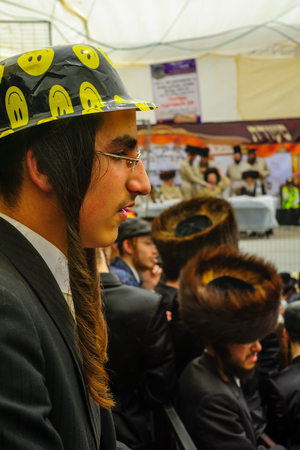 haredi: JERUSALEM, ISRAEL - FEBRUARY 25, 2016: A crowd and their Rabbi, part of a celebration of the Jewish Holyday Purim, in the ultra-orthodox neighborhood Mea Shearim, Jerusalem, Israel