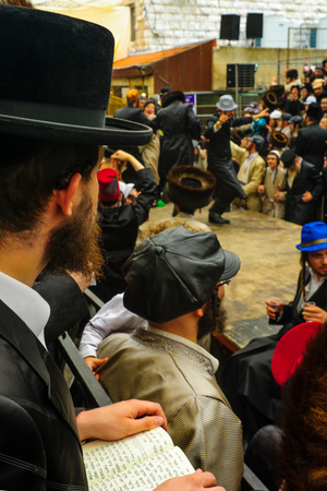 haredi: JERUSALEM, ISRAEL - FEBRUARY 25, 2016: Jewish man read a holy book, part of a celebration of the Jewish Holyday Purim, in the ultra-orthodox neighborhood Mea Shearim, Jerusalem, Israel Editorial