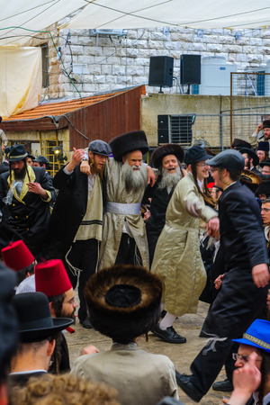 jewish: JERUSALEM, ISRAEL - FEBRUARY 25, 2016: Jewish men attend and dance, as part of a celebration of the Jewish Holyday Purim, in the ultra-orthodox neighborhood Mea Shearim, Jerusalem, Israel