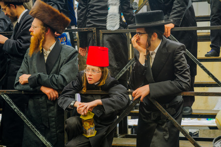 mea: JERUSALEM, ISRAEL - FEBRUARY 25, 2016: Jewish men attend a celebration of the Jewish Holyday Purim, in the ultra-orthodox neighborhood Mea Shearim, Jerusalem, Israel Editorial