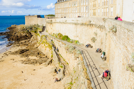 st  malo: ST. MALO, FRANCE - SEPTEMBER 25, 2012: View of the old city walls, with visitors, in St. Malo, Brittany, France Editorial