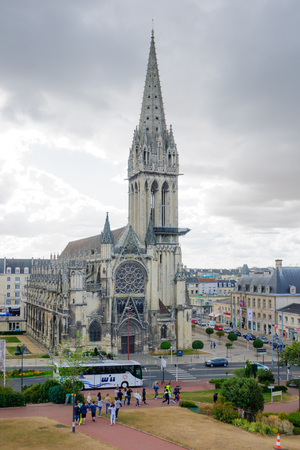 basse normandy: CAEN, FRANCE - SEPTEMBER 19, 2012: View of the Church of Saint-Pierre, with locals and visitors, in Caen, Normandy, France Editorial