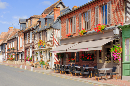 timber: BEUVRON-EN-AUGE, FRANCE - SEPTEMBER 18, 2012: Half-timbered houses and local businesses, in Beuvron-en-Auge, Normandy, France. It was awarded as the most beautiful villages of France Editorial