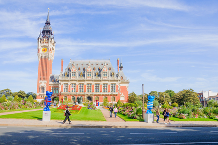 calais: CALAIS, FRANCE - SEPTEMBER 15, 2012: View of the town hall, with locals and visitors, in Calais, France