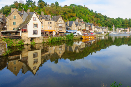 visitors area: DINAN, FRANCE - SEPTEMBER 25, 2012: The old port area, with local businesses, locals and visitors, in Dinan, Brittany, France Editorial