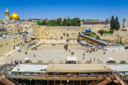 JERUSALEM, ISRAEL - APRIL 29, 2016: View of the western wall (Wailing Wall), Al-Aqsa Mosque and the Dome of the Rock, with locals and visitors. The old city of Jerusalem, Israel