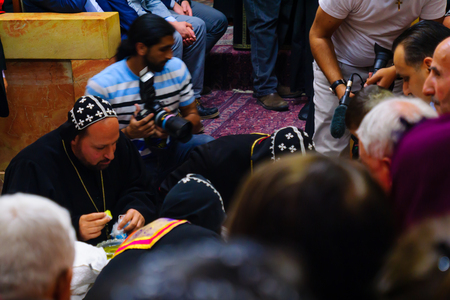 holy thursday: JERUSALEM, ISRAEL - APR 28, 2016: Washing of the Feet ceremony, in the Syrian Orthodox St. Marks church, with the patriarch and community members. Orthodox Holy Thursday in the old city of Jerusalem, Israel Editorial