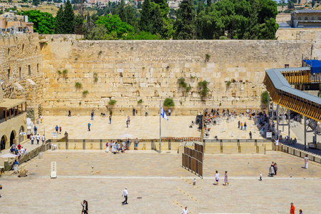 western wall: JERUSALEM, ISRAEL - APRIL 29, 2016: View of the western wall (Wailing Wall), with locals and visitors.  The old city of Jerusalem, Israel