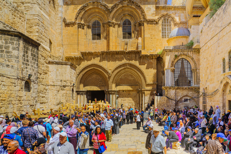 sepulcher: JERUSALEM, ISRAEL - APRIL 29, 2016: An Orthodox Good Friday scene in the yard of the church of the Holy Sepulcher, with pilgrims queuing at the entrance. The old city of Jerusalem, Israel