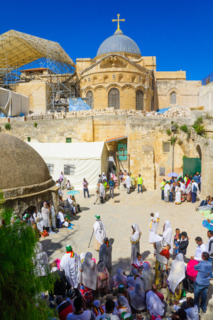 spirtual: JERUSALEM, ISRAEL - APRIL 29, 2016: A crowd of Ethiopian Pilgrims gather in the Deir Es-Sultan, part of the church of the Holy Sepulcher, in Orthodox Good Friday. The old city of Jerusalem, Israel Editorial