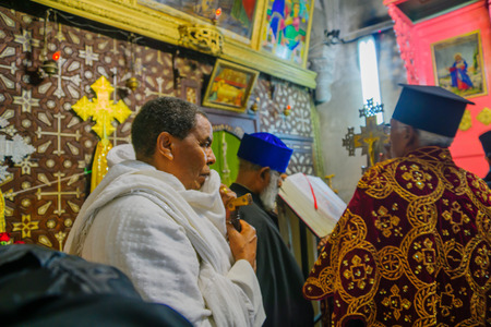 spirtual: JERUSALEM, ISRAEL - APRIL 29, 2016: An Orthodox Good Friday pray of the Ethiopian community. The church of the Holy Sepulcher, the old city of Jerusalem, Israel Editorial