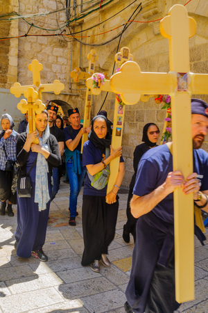 sepulcher: JERUSALEM, ISRAEL - APRIL 29, 2016: An Orthodox Good Friday scene in the yard of the church of the Holy Sepulcher, with pilgrims arriving. The old city of Jerusalem, Israel