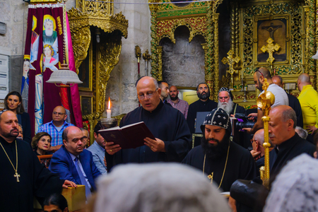 thursday: JERUSALEM, ISRAEL - APR 28, 2016: Washing of the Feet ceremony, in the Syrian Orthodox St. Marks church, with the patriarch and community members. Orthodox Holy Thursday in the old city of Jerusalem, Israel Editorial