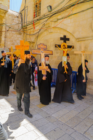middle easter: JERUSALEM, ISRAEL - APRIL 29, 2016: An Orthodox Good Friday scene in the yard of the church of the Holy Sepulcher, with pilgrims arriving. The old city of Jerusalem, Israel