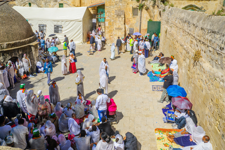 middle easter: JERUSALEM, ISRAEL - APRIL 29, 2016: A crowd of Ethiopian Pilgrims gather in the Deir Es-Sultan, part of the church of the Holy Sepulcher, in Orthodox Good Friday. The old city of Jerusalem, Israel Editorial