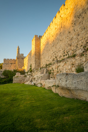 ancient buildings: Sunset view of the walls of the old city (south - west section), with the tower of David, in Jerusalem, Israel Editorial
