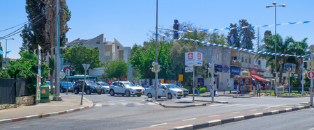 standstill: HAIFA, ISRAEL - MAY 11, 2016:  Scene of Yom Hazikaron (Israel Memorial Day for its soldiers), with people and traffic observe a two-minute standstill to a sound of a siren. Haifa, Israel