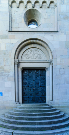 minster: A decorated door at the south-west side of the Grossmunster (great minster) Church, in Zurich, Switzerland