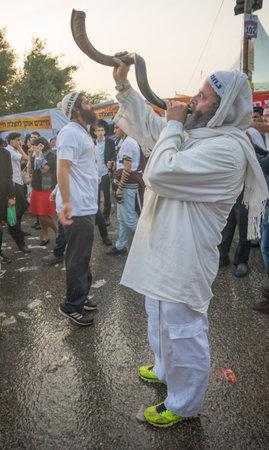 tefillin: MERON, ISRAEL - MAY 26, 2016: Jewish men blows a shofar at the annual hillulah of Rabbi Shimon Bar Yochai, in Meron, Israel, on Lag BaOmer Holiday