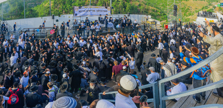 rabbi: MERON, ISRAEL - MAY 26, 2016: Panoramic view of a crowd of orthodox Jews, attending and dancing at the annual hillulah of Rabbi Shimon Bar Yochai, in Meron, Israel, on Lag BaOmer Holiday