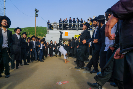 dance bar: MERON, ISRAEL - MAY 26, 2016: Orthodox Jews dance at the annual hillulah of Rabbi Shimon Bar Yochai, in Meron, Israel, on Lag BaOmer Holiday. This is an annual celebration at the tomb of Rabbi Shimon Editorial