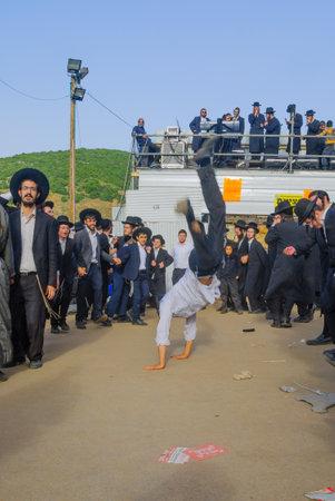 kabbalah: MERON, ISRAEL - MAY 26, 2016: Orthodox Jews dance at the annual hillulah of Rabbi Shimon Bar Yochai, in Meron, Israel, on Lag BaOmer Holiday. This is an annual celebration at the tomb of Rabbi Shimon Editorial
