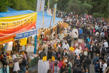 lag: MERON, ISRAEL - MAY 26, 2016: Scene of a crowd of orthodox Jews participants, and religious item sell stands, at the annual hillulah of Rabbi Shimon Bar Yochai, in Meron, Israel, on Lag BaOmer Holiday