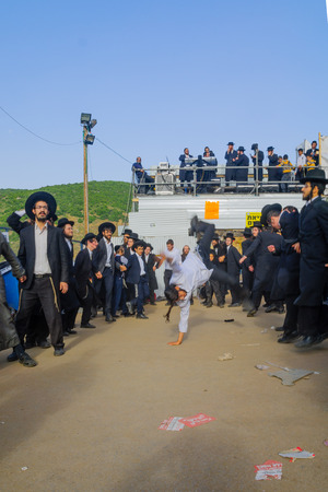 rabbi: MERON, ISRAEL - MAY 26, 2016: Orthodox Jews dance at the annual hillulah of Rabbi Shimon Bar Yochai, in Meron, Israel, on Lag BaOmer Holiday. This is an annual celebration at the tomb of Rabbi Shimon Editorial
