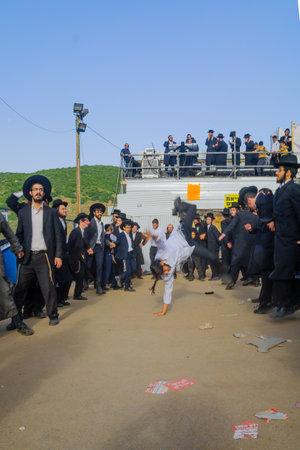 jews: MERON, ISRAEL - MAY 26, 2016: Orthodox Jews dance at the annual hillulah of Rabbi Shimon Bar Yochai, in Meron, Israel, on Lag BaOmer Holiday. This is an annual celebration at the tomb of Rabbi Shimon Editorial