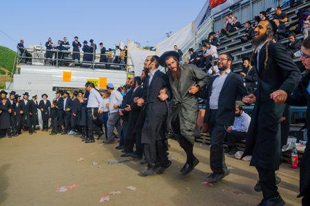tefillin: MERON, ISRAEL - MAY 26, 2016: Orthodox Jews dance at the annual hillulah of Rabbi Shimon Bar Yochai, in Meron, Israel, on Lag BaOmer Holiday. This is an annual celebration at the tomb of Rabbi Shimon Editorial