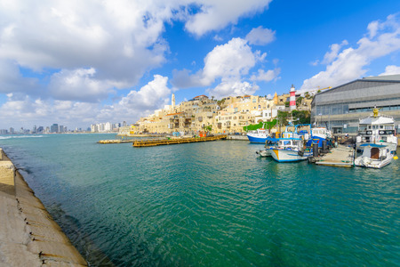 jaffa: TEL-AVIV, ISRAEL - MAY 27, 2016: View of the Jaffa port and of the old city of Jaffa, with locals and visitors, now part of Tel-Aviv Yafo, Israel