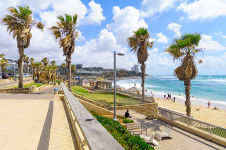 yafo: TEL-AVIV, ISRAEL - MAY 27, 2016: View of Givat Aliyah beach and nearby area, with locals and visitors, in the southern part of Jaffa, Now part of Tel-Aviv Yafo, Israel Editorial