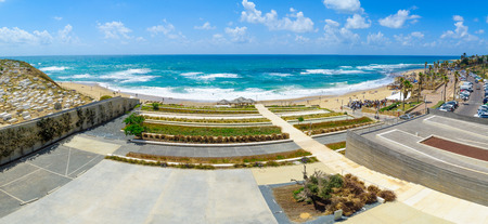 yafo: TEL-AVIV, ISRAEL - MAY 27, 2016: Panoramic view of Givat Aliyah beach and nearby area, with locals and visitors, in the southern part of Jaffa, Now part of Tel-Aviv Yafo, Israel